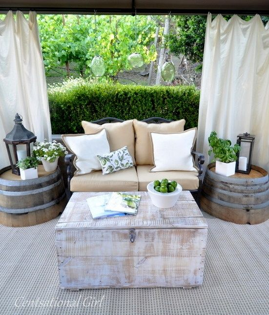 Oak Barrel planters from home depot or lowes turned upside down for side tables and Drop cloths for homemade type gazebo surrounding
