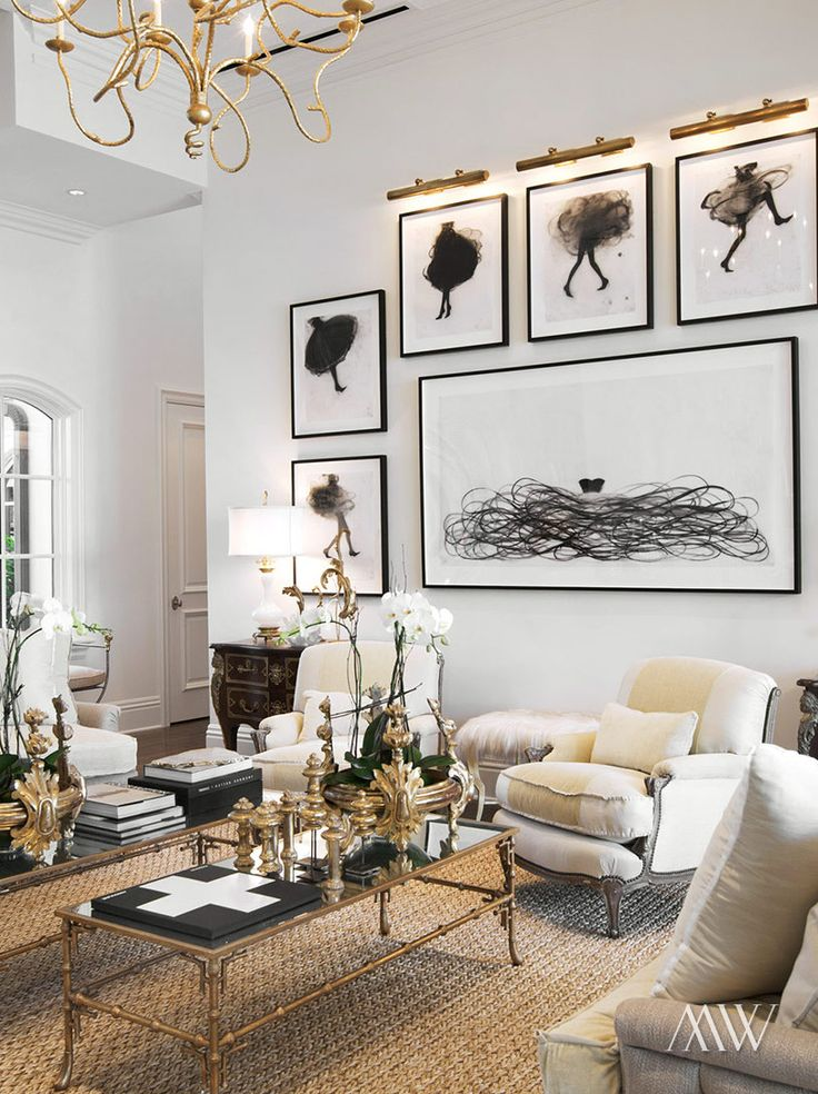 Modern French Living Room Features Linen Sofas Facing Each Other Across From Two Gold Bamboo Coffee Tables With Mirrored Tops Alongside A Pair Of