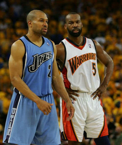 Derek Fisher Photos - Derek Fisher #2 of the Utah Jazz stands with Baron Davis #5 of the Golden State Warriors in Game 4 of the Western Conference Semifinals during the 2007 NBA Playoffs on May 13, 2007 at Oracle Arena in Oakland, California. The Jazz defeated the Warriors 115-101. NOTE TO USER: User expressly acknowledges and agrees that, by downloading and or using this photograph, User is consenting to the terms and conditions of the Getty Images License Agreement. - Utah Jazz v Golden…
