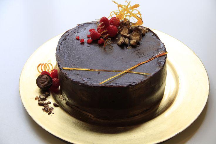 Gluten-free Chocolate Swiss roll with dark chocolate ganache and sugar art