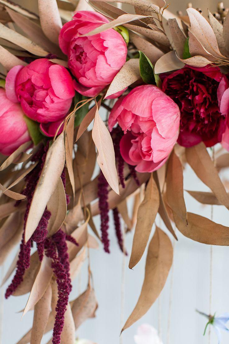 peony wedding arrangements - photo by Wesley Vorster http://ruffledblog.com/modern-chic-boho-fall-wedding-inspiration