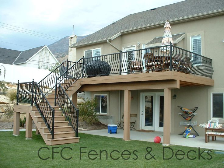 2nd story deck with Trex Decking - stairs should be off side not back. Love the plain pillars and simple connection to deck