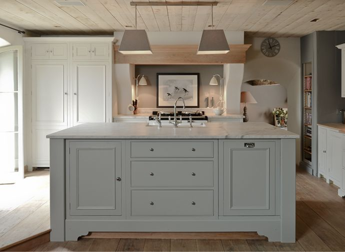 industrial kitchen island producing eclectic gorgeous kitchen with a pretty chalky colour palette and fabulous styling
