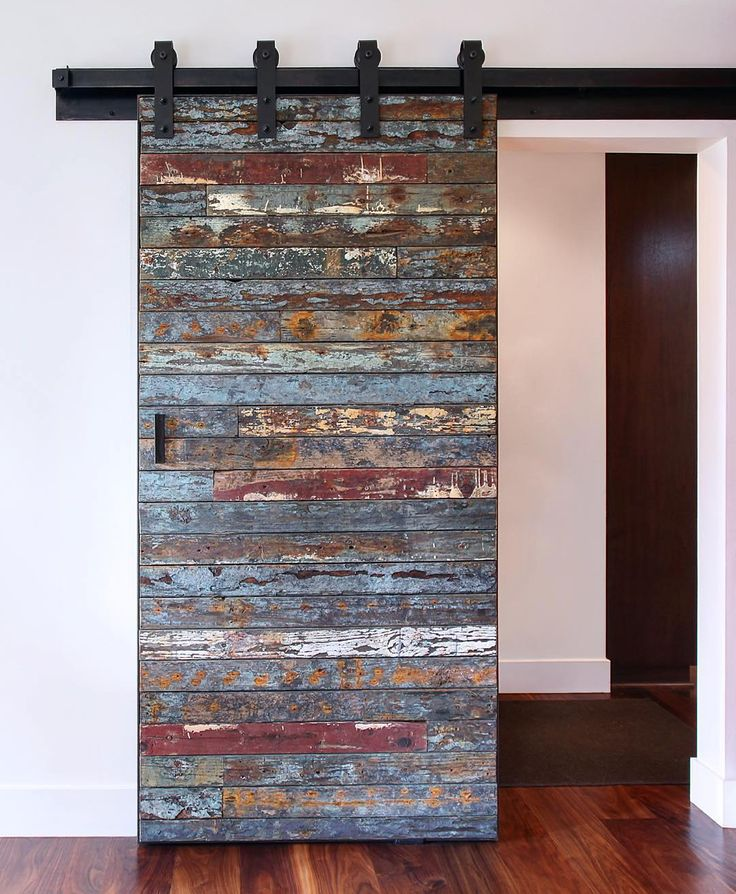 """""""This is not your ordinary barn door. Salvaged marine wood from a 40 year old bait barge which was destroyed by a swell in the Pacific Ocean from the 2011 Tsunami that hit Japan. We were lucky to get the remaining pieces to create this one of a kind sliding door!""""-@melissamorgandesign  Hung with our Industrial hanger."""