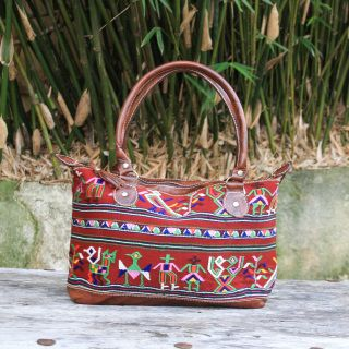 This hand crafted bag is a one of a kind. Featuring beautiful, soft Guatemalan leather and hand embroidered huipils. $150