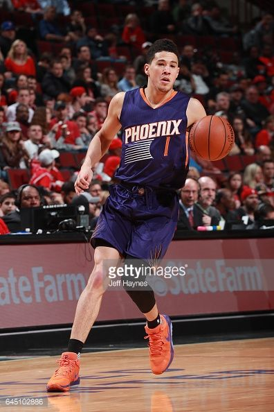 News Photo : Devin Booker of the Phoenix Suns handles the ball...