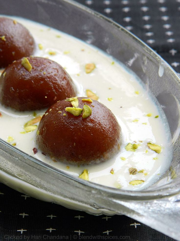 Gulab Jamuns with Rabri - A delicious dessert to celebrate the Indian festival of Colors, Holi.    RECIPE: http://www.blendwithspices.com/2013/03/gulab-jamuns-with-rabri-holi-festival.html