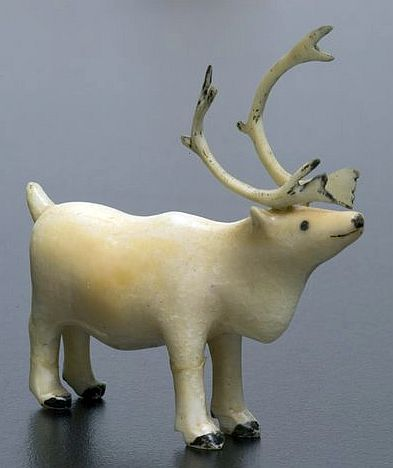 Ivory carving of a caribou from Inuit people active in Alaska.