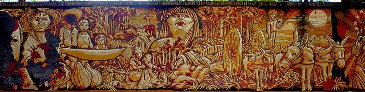 Mural de la Plaza Bartolomé Aquino, representa la fundación de la ciudad por repatriados venidos de Guaira que por ordenes de Don Carlos Antonio López llegaron a ésta zona para ocupar. Artista plástico Jorge Aguirre en el 2008