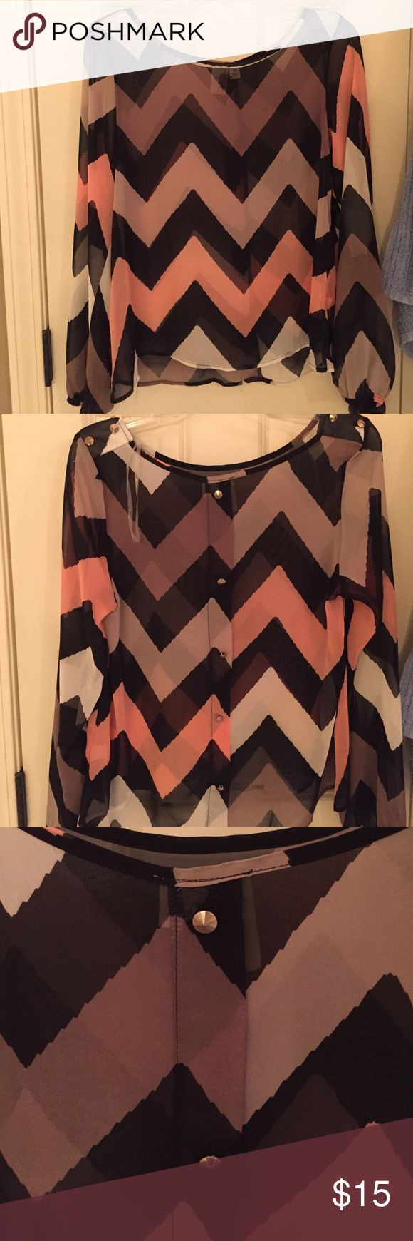 Polyester chevron top with spike embellishment Only worn once. This cute top could be worn out and styled with a bandeau, white jeans and heels. Purchased from Francesca's. Tops Blouses