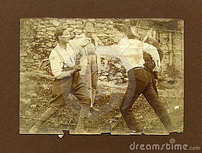 Taken in the north of Italy in 1920.Two men fighting during a boxing match.