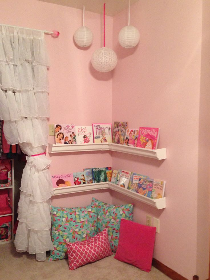 Reading corner in little girls room! We used plastic rain gutters from Lowes…