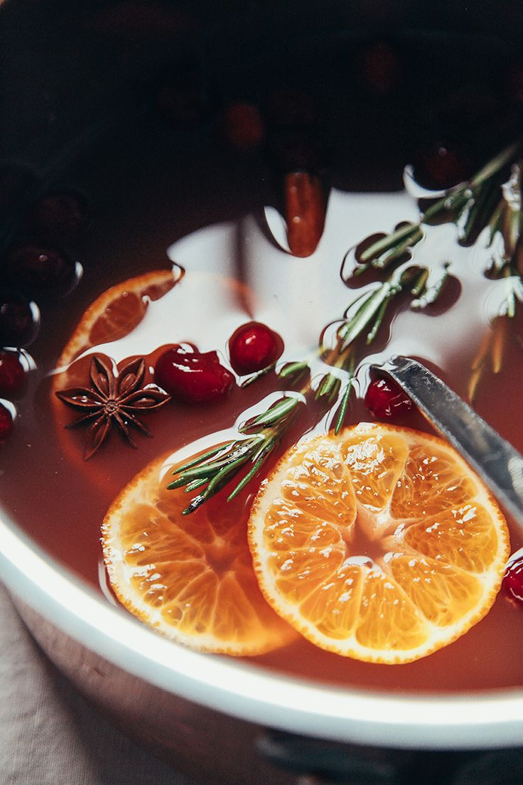 Mulled pomegranate cider with vanilla + rosemary via thefirstmess.com