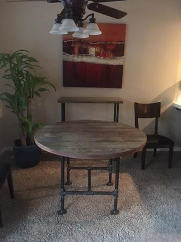 This is a industrial/salvaged wood round dining table and matching sofa table we built! I bet there Easter meal will taste even better on their new Silverado table.