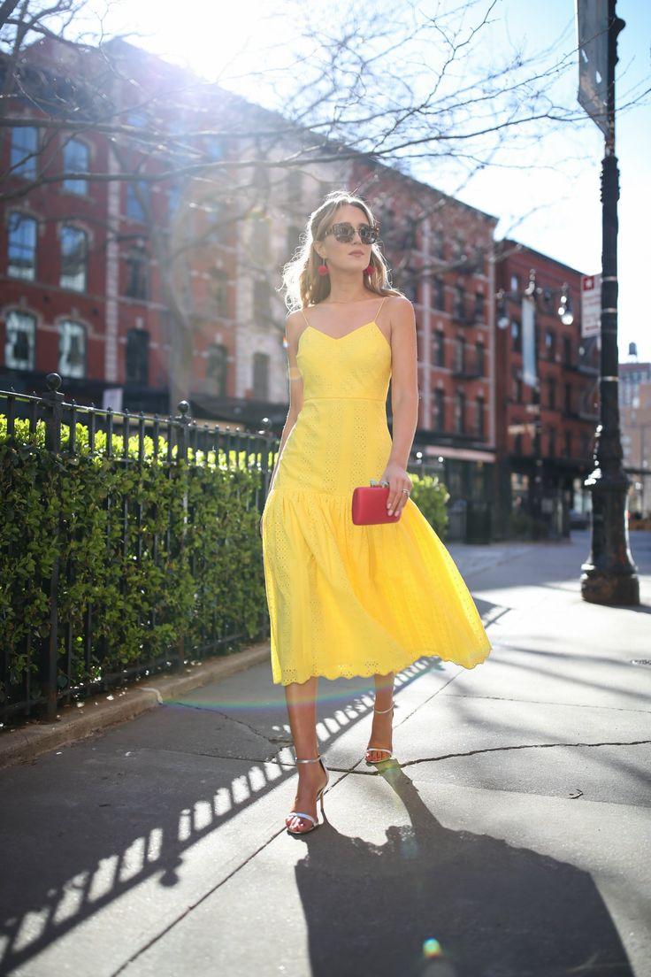 top-spring-fashion-trends-yellow-eyelet-j-crew-midi-dress-silver-metallic-heeled-sandals-red-clutch-tassel-earrings3