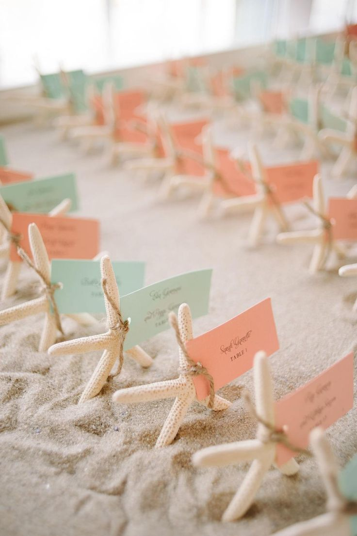 ideas for beach wedding party favors%0A Starfish  escort cards  sand  aqua  u     coral  beach wedding    kml