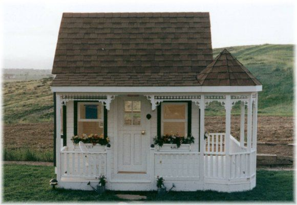 Victorian Chalet features a wrap porch with turret area.   OMG!!! This is sooooo beautiful.