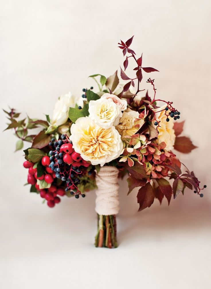 A beautiful autumnal bouquet with a mixture of berries, David Austen Roses, and Hydrangeas. This would suit a bride's dress that is very vintage with lace and chiffon.