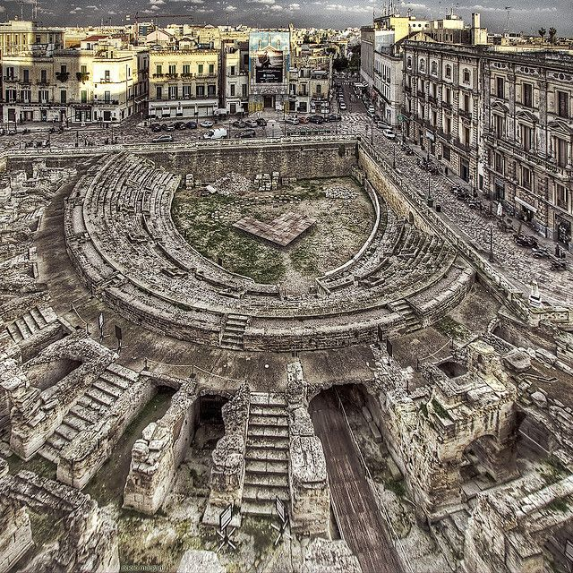 Roman amphitheater ruins - Lecce, Italy..wonder if this was used to throw people to wild animals for entertainment?