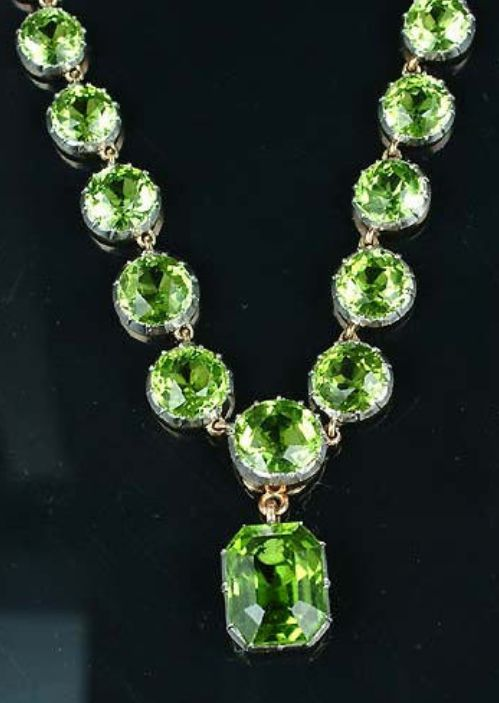 A late 19th century peridot necklace,  designed as a graduated rivière of collet-set circular-cut peridots, the detachable pendant similarly-set with an octagonal step-cut peridot; accompanied by a pair of circular-cut peridot earstuds, mounted in gold and platinum, length 36.5cm