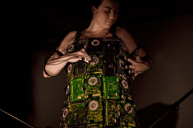 A musical performance dress built by Nicky Assmann with 35 old circuit board stitched together. Ultimately, the idea of the musical circuit dress is to display what many people consider ugly when it comes to technology: the innards of a device with its circuit boards, the wires and the chips.