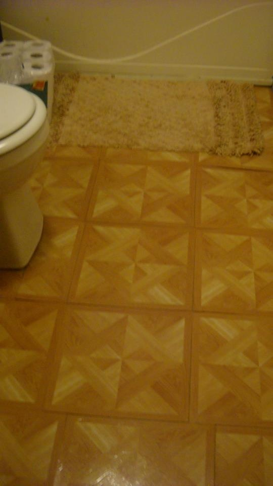 We layed sticky tiles in the bathroom!!