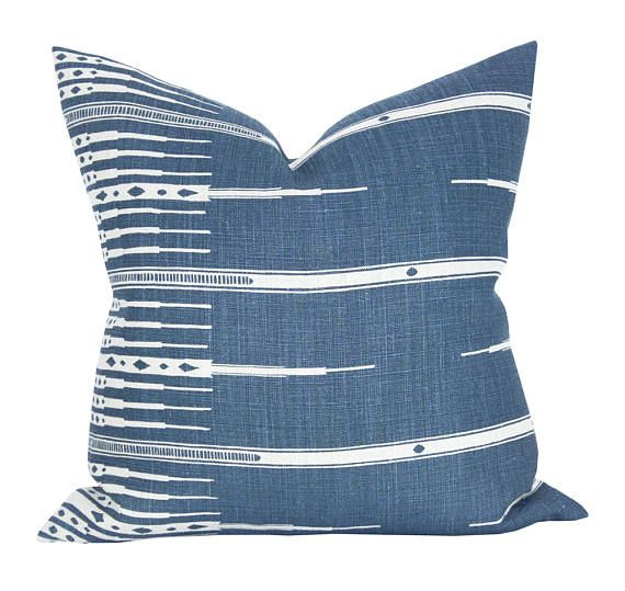 This listing is for one Tangiers Indigo/Natural pillow cover with the same fabric ON BOTH SIDES.   DESCRIPTION Fabric made by: Peter Dunham Textiles Pillow made by: Spark Modern Colors: Indigo, natural (oatmeal)   DETAILS Pattern placement WILL VARY from the listing photos. This pattern features a large stripe that will either be offset or centered. This is a rustic fabric with print and weave variations.  The pillow cover shown in the listing photo is 20 x 20 with a 22 down blend insert...