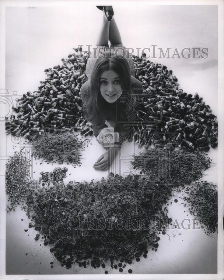 1969 Press Photo Model holding a new Texas Instruments electric circuit
