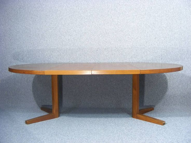 A wonderful Danish extending dining table designed by John Mortensen  Seats up to 10, ideal for large family occasions, Christmas etc...   The table Combines great design and quality construction  Superb patina with fabulous colour, grain and sheen  Table extends via two extra leaves which can be used independently allowing the table to be extended to three different lengths  Beautiful solid construction