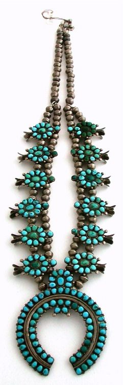 Looks like a fairly old squash blossom necklace with two tone turquoise.