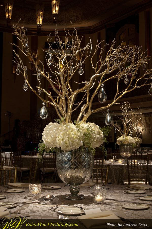 Wedding centerpiece in mercury glass with white hydrangea