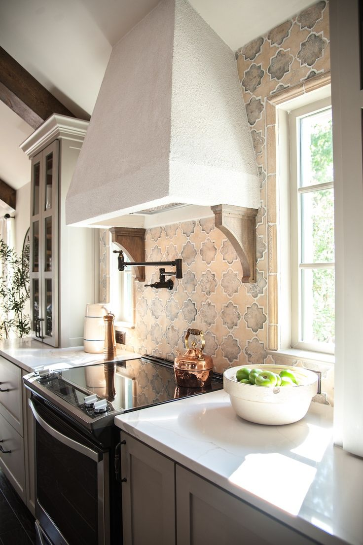 We did a stucco vent hood to match the stucco fireplace and keep the same feel throughout the house.
