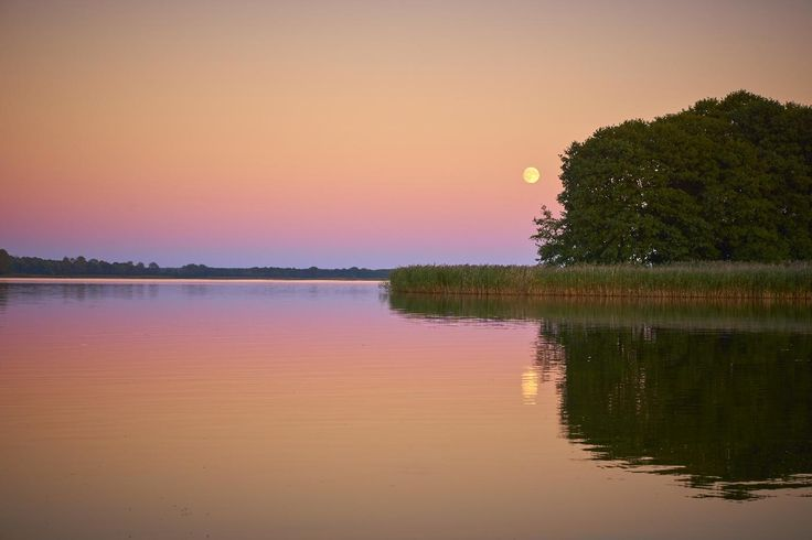 Moon after sunset over the mazury lakes.