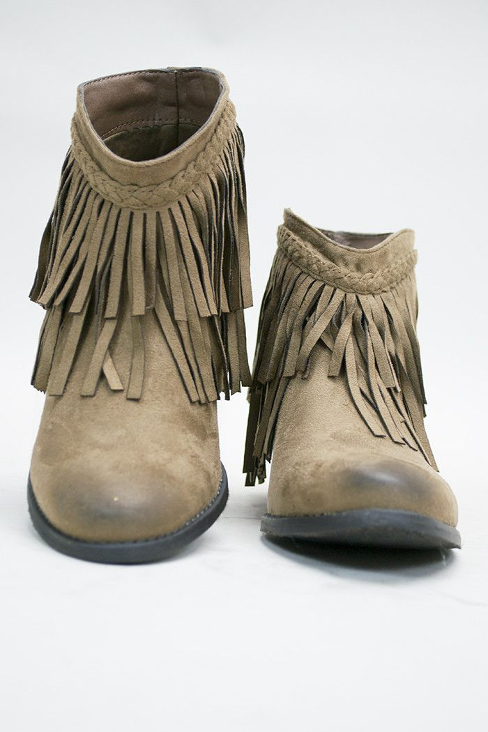 Sold out sizes will be coming back by January. A classy design of a cowgirl boot and a fringe bootie. Suede texture with two layers of fringe around the top. Braided finish on top of the fringe. Heel
