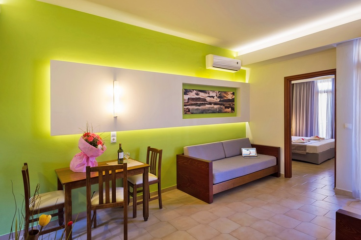 The beautiful and modern interior design at Oscar Suites & Village. Complete with sofas, dining area, private balcony, TV, fully equipped kitchen and air-condition