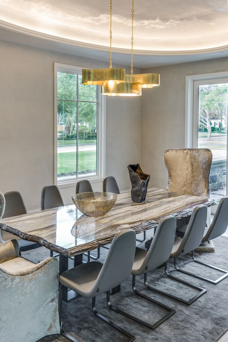 As A Statement-Making Dining Room Table - Calacatta Cielo Petrified Wood Dining TableCalacatta marble from Italy sourced by Aria Stone Gallery. Table designed by Pamela Frederick.
