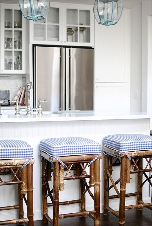 Charming beach cottage kitchen and barstools.  Love the white kitchen with blue and white accents.