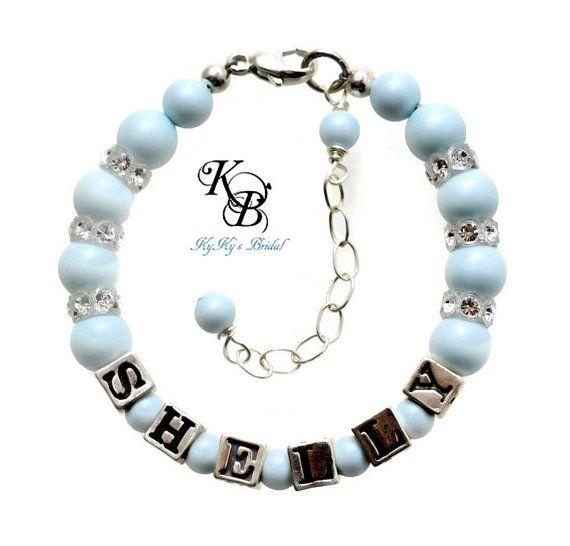 Pastel Flower Girl Name Bracelet in your choice of pastel pearl color. #flowergirlbracelet #flowergirlgift #namebracelet #pasteljewelry