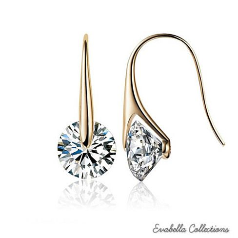 Certain things have an aura of sophistication and richness to them that is inherent and cannot be copied or borrowed. Same can be said about these boutique diamond charming Swarovski drop earrings. Perfect accent for any night on the town or company event.