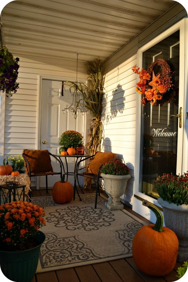 Fall Porch. Plus I love the large rug out front!