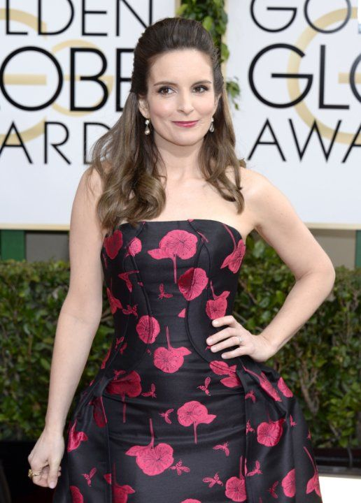I love how girly Tina Fey looks! Not the dress I would have chosen but she looks pretty amazing.  #2014GoldenGlobes #RedCarpet