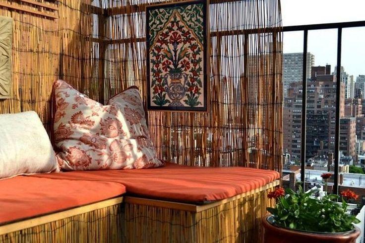 brise-vue balcon bambou canapé et coussins