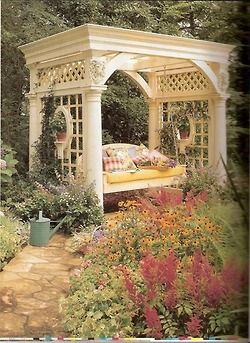 Oh, what a lovely addition to the backyard gardens.  The perfect spot for a nap or reading a good book.  Drool...