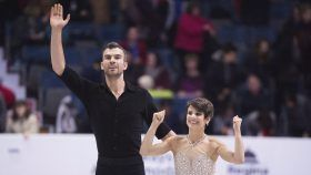Meagan Duhamel and Eric Radford captured bronze at Skate America on Saturday, securing themselves a spot in the Grand Prix...