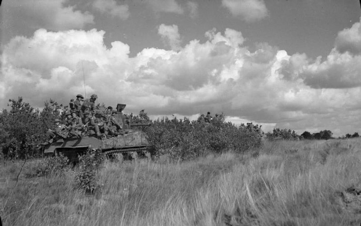 A Sherman Firefly tank and infantry of 11th Armoured Division during the advance in Belgium, 10 September 1944