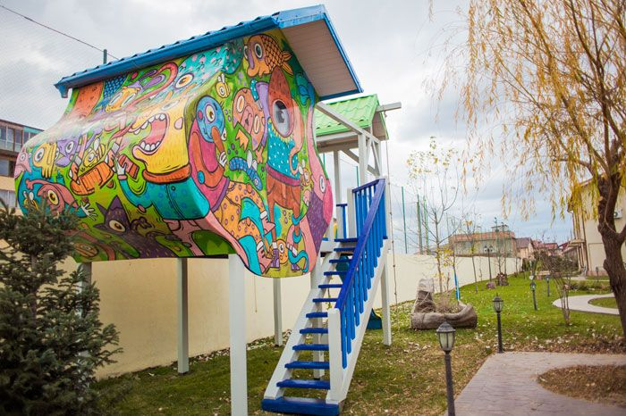 Wooden Playhouse in Bucharest with creative paintings for kids.