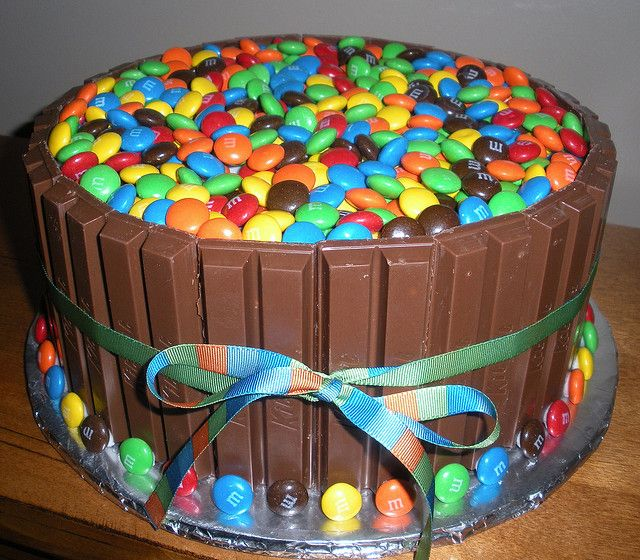 OMG!! This would rock Jason's world!!      Kit Kat Cake by Tasty Cakes by Jennifer, via Flickr use smarties as substitute for m and m's
