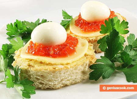 canapes with red caviar and quail eggs