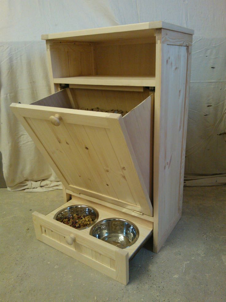 Dog food cabinet with bowls.