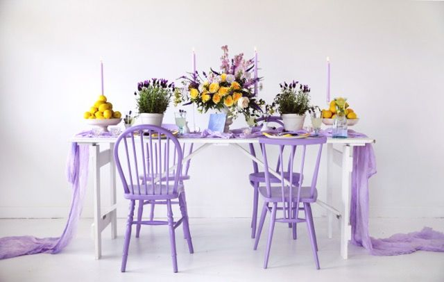 Gorgeous lavender and lemon styling by @elleinspirehire using our purple vintage chairs and white trestle table